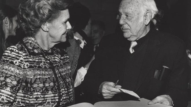 Paul Strand with an unidentified woman waiting for him to sign her book in 1971.