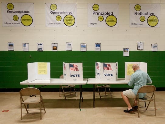 Voters cast their ballots in the presidential primary