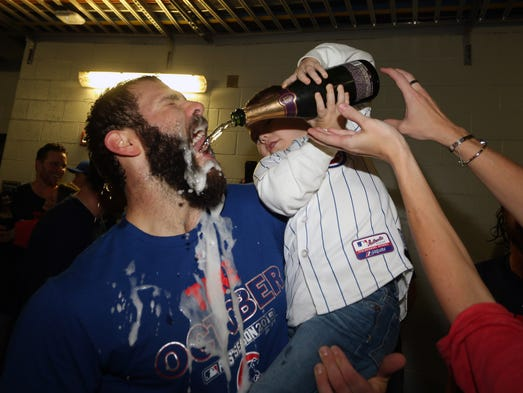 Cubs starting pitcher Jake Arrieta celebrates with