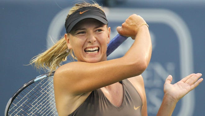 Maria Sharapova returns the ball during her match with Vera Zvonareva at the Western & Southern Financial Group Masters tennis tournament open in August of 2011.