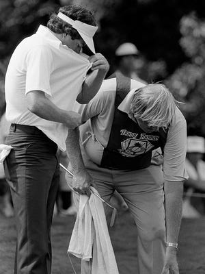 Professional golfer Mark Lye (left) had a bug problem as he waited to hit at the seventeenth hole on the South Course of Colonial Country Club during the second round of the Danny Thomas Memphis Classic on 11 June 1982.
