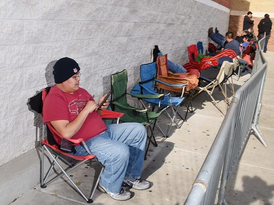 Herschel Sherman makes himself comfortable in front of Best Buy in Farmington on Thursday. Sherman said he arrived at the store at 6 p.m. Wednesday to be first in line when the store opened at 5 p.m. Thanksgiving