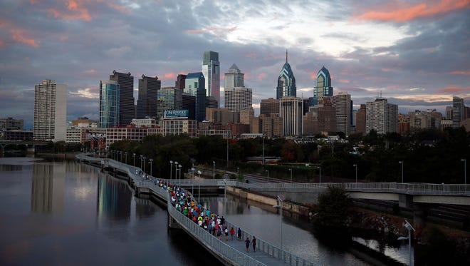 Runners jog along the boardwalk in Philadelphia. Democrats have selected Philadelphia as the site of the party's 2016 national convention.