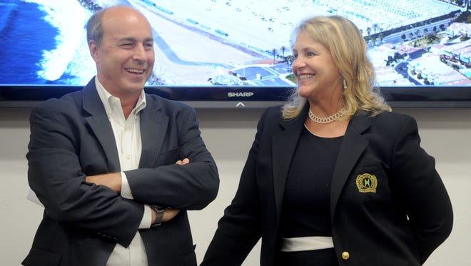 Timothy Child, left, of SeaLand, talks with port Commissioner Mary Anne Rooney during Tuesday's celebration of SeaLand's launch of its West Coast-to-Central America operation at the port.