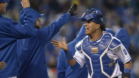 Kansas City Royals catcher Salvador Perez (13) is congratulated by team mates after the game against the Cincinnati Reds at Kauffman Stadium.