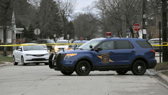 Michigan State Police investigate a police shooting Wednesday morning, Dec. 17 on Bancroft Street near 10th Street. The incident occurred late Tuesday night.