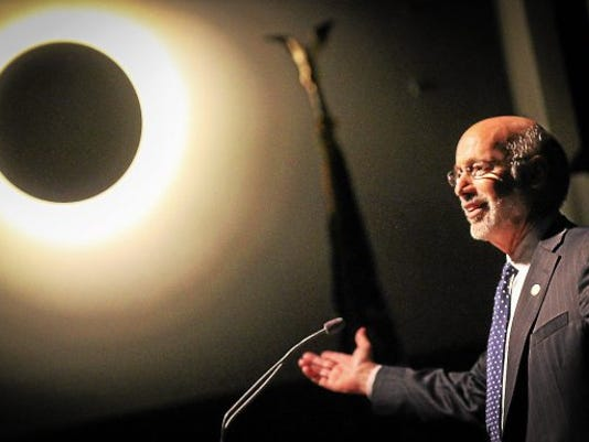Pennsylvania Gov. Tom Wolf lights up a packed crowd at The Hill School Center for Performing Arts on Thursday.