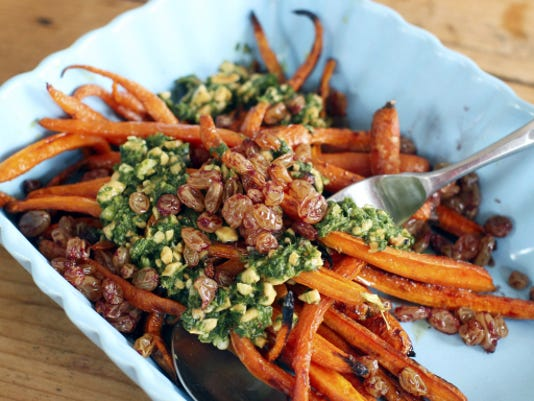 Roasted carrots with port raisins and peanut herb sauce.
