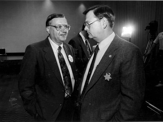 Arpaio (left) talks with J.R. Armer, a Democratic candidate for sheriff, after each won his party's nomination on primary Election Night in 1992. Arpaio edged incumbent Sheriff Tom Agnos by 6,000 votes.