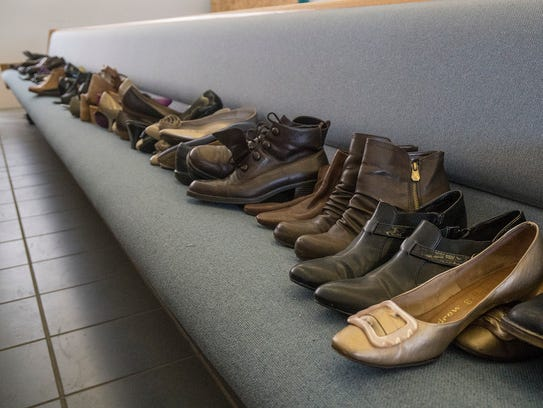 Shoes are lined up in the pews of the former sanctuary,