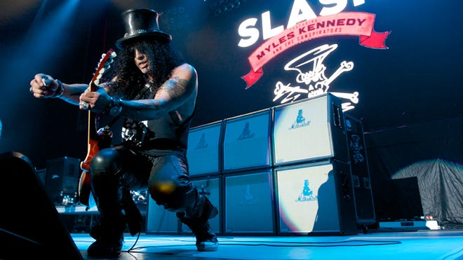 Guitarist Slash plays with his band, The Conspirators, at The Forum on July 30, 2014, in Inglewood, Calif.