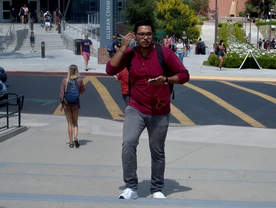 Jose Mendoza walks to class at California Lutheran