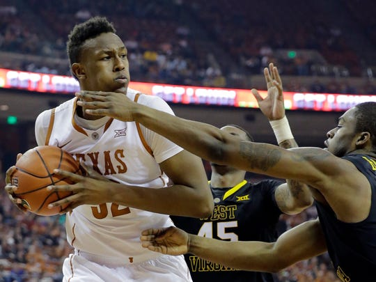 Texas' Myles Turner (52) is pressured by West Virginia's Elijah Macon (45) and BillyDee Williams, right, during the first half of an NCAA college basketball game, Saturday, Jan. 17, 2015, in Austin, Texas.