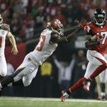 The Falcons' Devin Hester (17) returns a punt as the Tampa Bay Buccaneers' Bobby Rainey defends on Sept. 18, the night Hester broke Deion Sanders' record for return touchdowns.