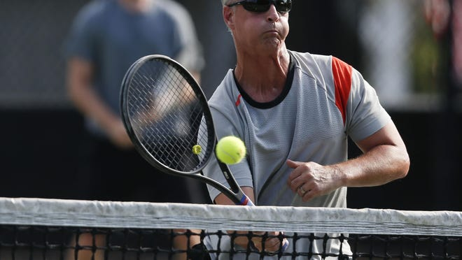 Dustin Clary partnered in doubles with his son, Dalton, at the 2019 Pritchett-Moore Men's City Invitational. Indian Hills' annual tennis tournament is celebrating its 45th event, though, because of COVID-19 safety measures that will be in place, the protocol for this year's tournament will be different than in year's past.