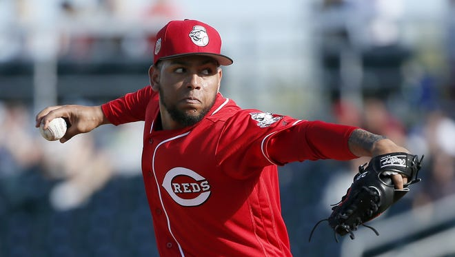 Cincinnati Reds relief pitcher Ariel Hernandez (69) delivers a pitch in the bottom of the eighth inning.