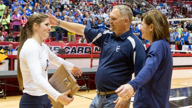 Senior Cameron Onken greet her parents on the court after receiving the IHSAA Mental Attitude award on Saturday .
