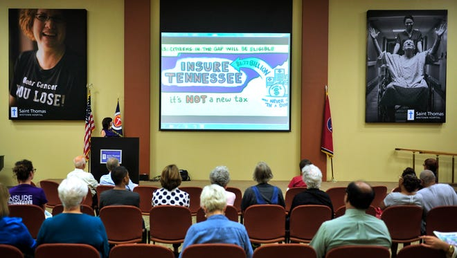 """People watch a short video about Insure Tennessee during the """"Counting the Cost"""" tour at Saint Thomas Midtown Hospital in Nashville on Tuesday, Aug. 17, 2015."""