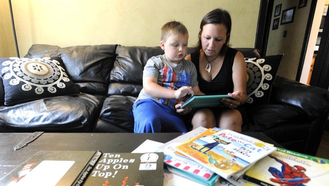 Parent Dawn Banks has mixed feelings about the new law as her son, Alasdair, heads into first grade at Pattengill Elementary in Berkley. Her son is in the first class affected by the tougher rules.