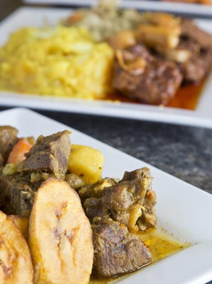 Curry Goat with rice and peas and plantains from Island Vibes.