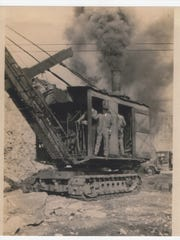A historic photo from Phenix Mining Co., shows mining operations. The once-thriving community is now a ghost town.