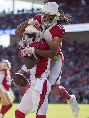 Arizona Cardinals wide receiver Jaron Brown is congratulated