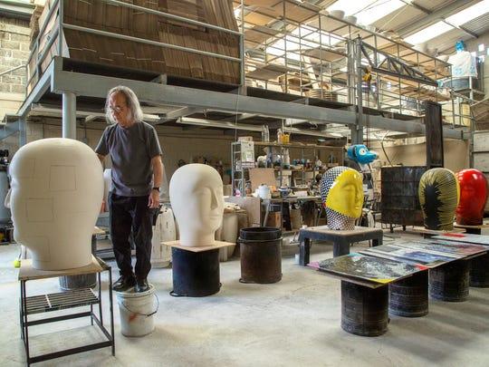 Artist Jun Kaneko works at glazing raku ceramic heads