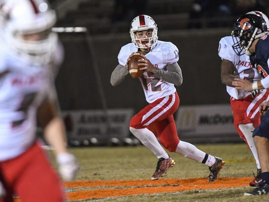 Palmetto sophomore Blair Garner rolls out to pass against