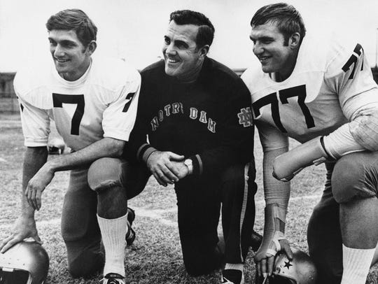 Ara Parseghian, center, Joe Theismann, left, and Mike