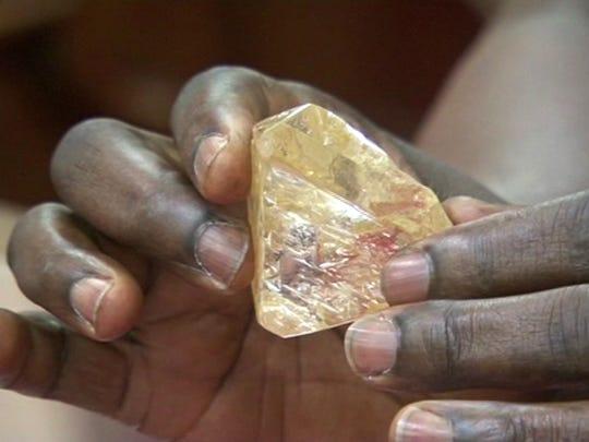 Sierra Leone's President Ernest Bai Koroma holds the