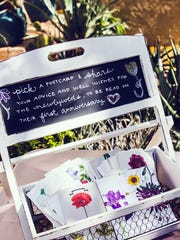 This April 18, 2015 photo provided by Austin Busy Brides shows postcards for a wedding at Desert Botanical Garden, that guests were asked to write well wishes on and return or mail back to the couple throughout the year, in Phoenix, Ariz. The couple planned to read them on their first anniversary.