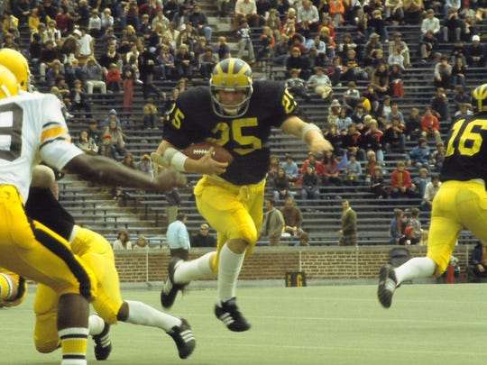 Wearing No. 25 as a sophomore, University of Michigan running back Rob Lytle runs with the ball against the University of Iowa in the Wolverines' season-opener on Sept. 14, 1974.