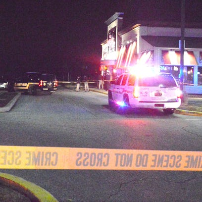 Police investigate a fatal shooting at TGI Friday's