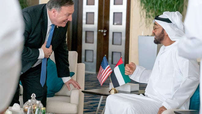 U.S. Secretary of State Mike Pompeo, left, and Abu Dhabi's Crown Prince Sheikh Mohammed bin Zayed Al Nahyan meet at the Al Shati Palace in Abu Dhabi, United Arab Emirates, Tuesday, July 10, 2018. Pompeo is on a trip traveling to North Korea, Japan, Vietnam, Afghanistan, Abu Dhabi, and Brussels.