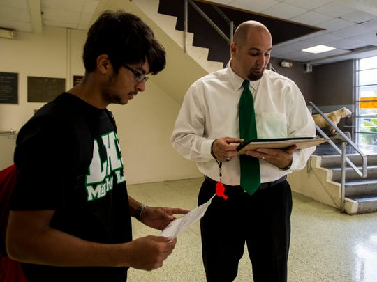 Lafayette High Principal Donald Thornton helps students navigate their class schedules on the first day of school.