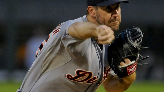 Detroit Tigers starting pitcher Justin Verlander delivers against the Chicago White Sox during the first inning of a baseball game in Chicago, Friday, Aug. 29, 2014. (AP Photo/Matt Marton)