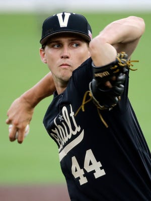 FILE - In this June 4, 2016, file photo, Vanderbilt starter Kyle Wright pitches against Washington in the first inning of an NCAA college baseball regional tournament game, in Nashville, Tenn. Wright is continuing the Commodores' history of producing blue-chip pitching prospects and could get taken first overall in Monday's draft. First he wants to help Vanderbilt reach the College World Series for the thirid time in four yearrs by knocking off No. 1 seed Oregon State in an NCAA super regional that begins Friday in Corvallis, Oregon. (AP Photo/Mark Humphrey, File)