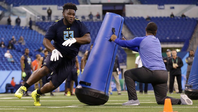Mississippi defensive lineman D.J. Jones runs a drill at the NFL Scouting Combine on Sunday.