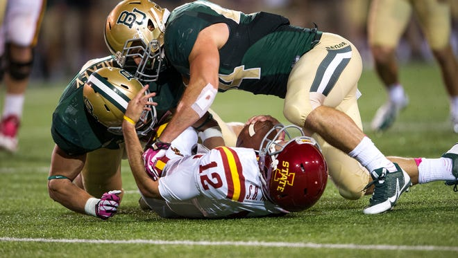 Baylor Bears linebacker Eddie Lackey (5) and linebacker Bryce Hager (44) sack Iowa State Cyclones quarterback Sam B. Richardson (12) during the second half at Floyd Casey Stadium. The Bears defeated the Cyclones 71-7.
