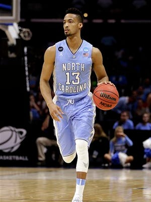 North Carolina forward J.P. Tokoto (13) will forgo his final year of college eligibility to enter the NBA draft.