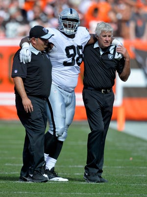 Oakland Raiders defensive end C.J. Wilson is helped off the field in the second half against the Cleveland Browns on Sept. 27, 2015, in Cleveland.