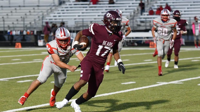 Bastrop's Demire Thompson tries to pull away from a Travis defender during the Bears' 38-10 win last week. Thompson had 118 yards and three touchdowns on just 10 carries in the win. Bastrop will face Rouse Thursday in a crucial District 13-5A DII contest.