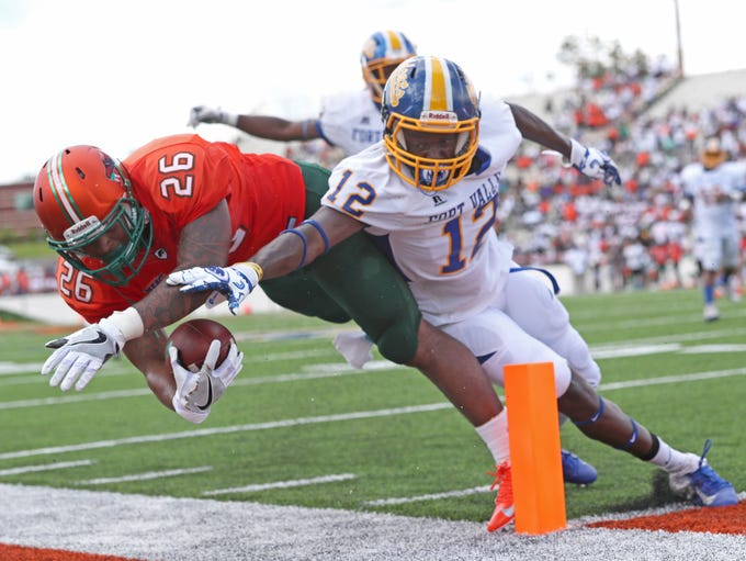 FAMU's Kevin Newman fights his way to the one yard