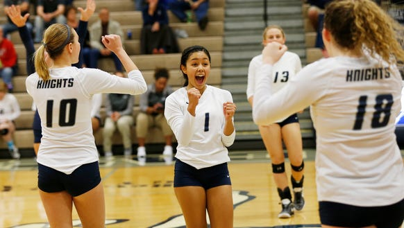 Sami Royer (1) and her Central Catholic teammates react