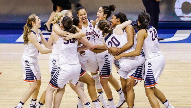 UConn players celebrate yet another national championship Tuesday night at Bankers Life Fieldhouse.