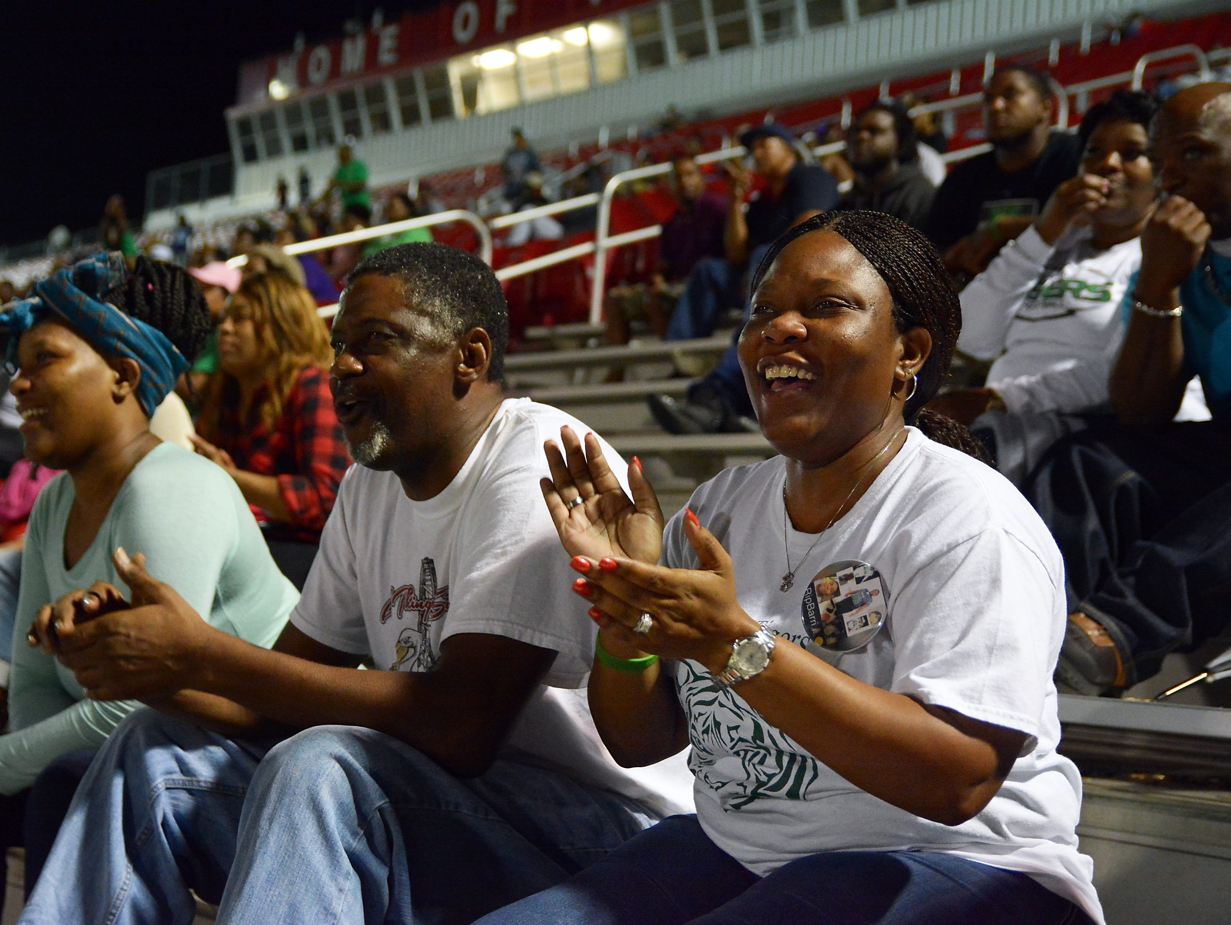 Montoyia McInnis, right, mother of former Collins High football player Jabarri Goudy, looks on during the Tigers' first-round playoff game Nov. 6. Goudy was killed in a shooting in July outside Club Memories in Hattiesburg.