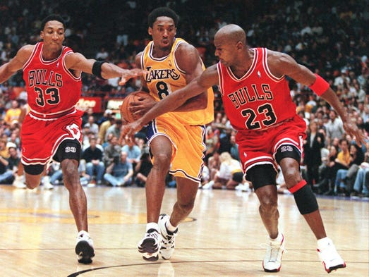 Scottie Pippen and Michael Jordan try to stop Kobe