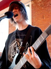 Elijah Reiter, 16, of Salem, sings and plays the guitar during a rehearsal for the River City Rock Star Academy at the Reed Opera House in Salem on Tuesday, April 14, 2015.