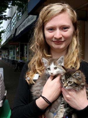 Willamette Humane Society Foster and Rescue Coordinator Ashleigh Young holds kittens Snowflake and Gummy who will be up for adoption at the Kitten Shower on May 7.