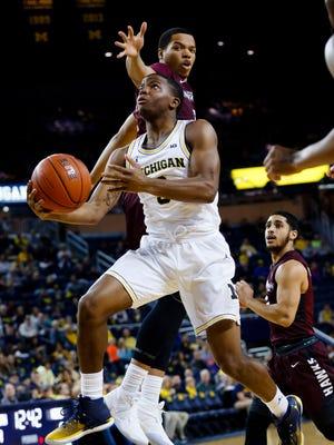 Dec 17, 2016; Ann Arbor, MI, USA; Michigan Wolverines guard Xavier Simpson is defended by Maryland-Eastern Shore Hawks forward Tyler Jones in the first half at Crisler Center.